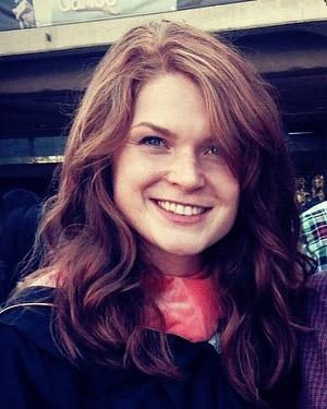 A headshot of Courtney