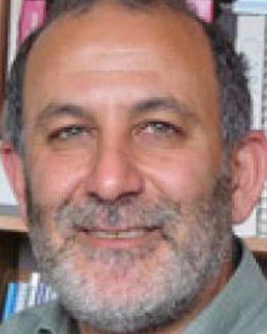 A headshot of James